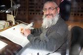 Rabi writing Torah — Stock Photo