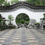 Circle entrance of Chinese garden in Hong Kong — Stock Photo #14586093