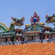 Colorful dragon statue on china temple roof. - Stock Photo