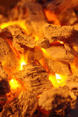 Decaying red coals of a tree in a fire — Stock Photo