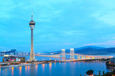 Cityscape in night with famous travel tower near river in Macao, — Stock Photo