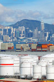 Huge Oil tanks and ship in city at day — Stock Photo