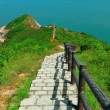 Hiking path surrounded by the sea — Stock Photo