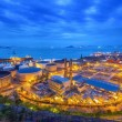 Photo: Gas storage spheres tank in petrochemical plant in sunset