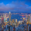 Sunset of cityscape in Hong Kong - Stock Photo