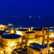 Stock Photo: Oil tanks at night