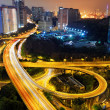 Stock Photo: Busy traffic night in finance urban
