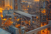 Industrial pipelines of oil-refinery plant — Stock Photo
