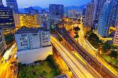 Busy traffic night in finance urban — Stock Photo