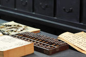 Abacus and book in chinese old shop — Stock fotografie