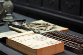 Abacus and book in chinese old shop — Stock Photo