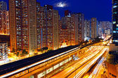 Busy highway train traffic night in finance urban — Stock Photo