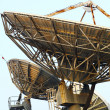 Satellite Communications Dishes on top of TV Station — Stock Photo