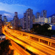 Stock Photo: Busy highway train traffic night in finance urban