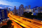 Busy highway train traffic night in finance urban — Stockfoto