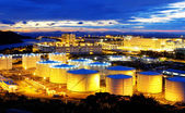 Oil tank in sunset — Stock Photo