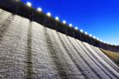 Dam and discharge flood water — Stock Photo