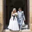 Bride and Groom leaving the church — Stock Photo #12641977