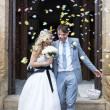 Bride and Groom outside the church — Stock Photo #12642157