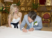 Bride and Groom signing the register — Stock Photo