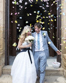 Bride and Groom outside the church — Stock Photo