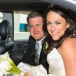 Bride and Groom in their wedding car — Stock Photo