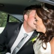 Bride and Groom in the weding car — Stock Photo