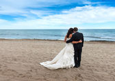Bride and Groom on their wedding day on the beach — Stock Photo