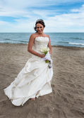Bride on her wedding day on the beach — Stock Photo