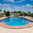 Typical swimming pool in Southern Spain — Stock Photo