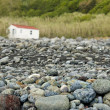 Stock Photo: Acores deserted rocky beach with small house