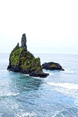 Single rocks in front of east coast of flores island — Stock Photo