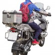 Stock Photo: Man on a motorcycle with a bag