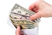 Dólares en efectivo en la envoltura — Foto de Stock