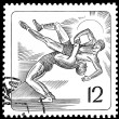 Greco-Roman wrestling on a postage stamp - Stock Photo