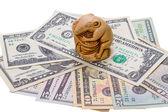 Netsuke rat and US dollar bills — Stock Photo