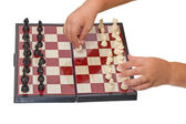 Child makes a move chess pawn — Stock Photo