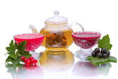 Currant jam and teapot with green tea — Stock Photo