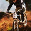 Autumn extreme mountain bike competition — Stock Photo #13160152