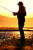 Fisherman silhouette — Stock Photo