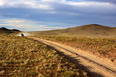 Car on road in the Mongolia — Stock Photo