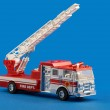 Fire dept car toy on blue — Stock Photo #2692698