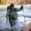 Stock Photo: Backpacker and mountain river