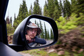 Self-portrait in driving car — Stock Photo