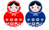 Cute Russian Matreshka dolls - red and blue — Stock Vector