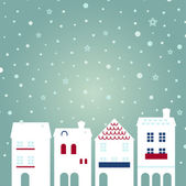 Christmas city on snowing background — Stock Vector