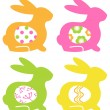Colorful easter bunnies with eggs isolated on white — Stock Vector