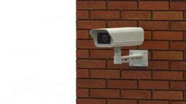 Rotating surveillance camera on brick wall — Stock Video