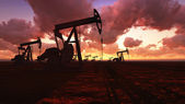 Oil field at sunset — Stock Photo