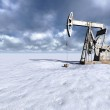 Oil field at snow — Stock Photo